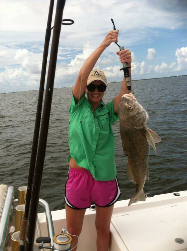 Showing off a big black drum while fishing in fort morgan for Fort morgan fishing charters